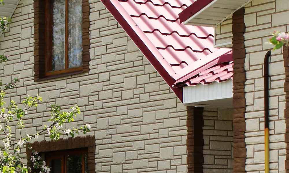 Облицовка дома сайдингом под камень