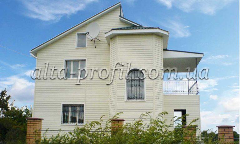 Фото дома с бежевым сайдингом Alta Siding