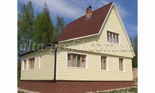 облицовка дома обшитого сайдингом флекс желтого цвета от Альта-Профиль