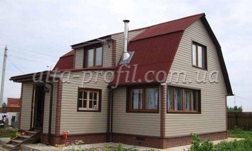 фасад дома обшитого сайдингом флекс сандалового цвета от Альта-Профиль
